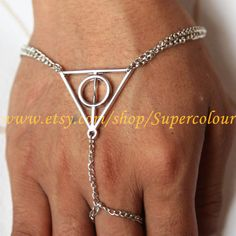 Harry potter Deathly Hallows ,steampunk ring and bracelet with chain. $4.99, via Etsy.