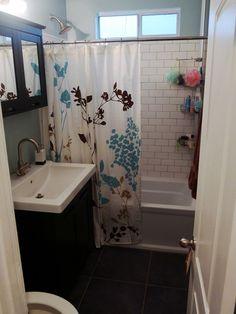 This looks like my upstairs bath! White subway tile, dark vanity, exact same shower curtain...