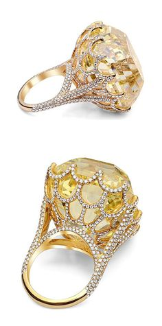 The Cullinan yellow diamond. The ring itself is rose gold and it is set with hundreds of small white diamonds to compliment the beautiful yellow centre stone to enhance the intensity of the yellow gem.