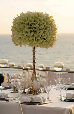 I like this kind of centerpiece-- if the flowers are more wild