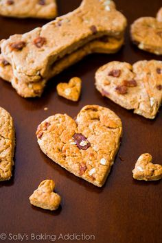 Homemade Dog Food Peanut Butter Bacon bones and hearts from a homemade dog treat recipe from Sally's baking addiction - We all look forward to tasty treats now and then, and our four-legged friends are Bacon Dog Treats, Pumpkin Dog Treats, Healthy Dog Treats, Pet Treats, Dog Biscuit Recipes, Dog Treat Recipes, Dog Food Recipes, Homemade Peanut Butter, Homemade Dog Treats