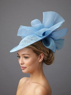 The Havilland dish hat includes a sinamay dish base with a froth of crinoline above and below the dish to the back, on a hair colour matched head band.