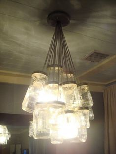 I've got to replace the fugly light fixture in my kitchen. Maybe something like this..?