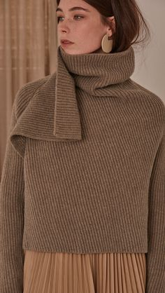Cecil Sweater in Beige. Rollback collar with pointed wide cowl neck. Drop shoulder design, open rib details. Short length in open back. Designed to be loose fit. COMPOSITION AND CARE Dry Clean Only Do