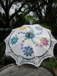 Some colorful airbrushing on a simple white parasol transforms it into a wearable work of art.
