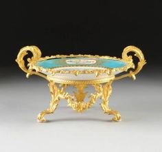 A SÈVRES STYLE GILT BRONZE MOUNTED AND POLYCHROME PAINTED TURQUOISE GROUND COMPOTE, ARTIST'S SIGNATURE R. PETIT, 19TH CENTURY,