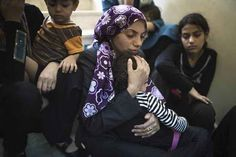 Mother comforts child after being attacked in a school in gaza