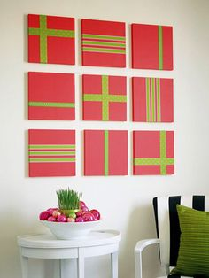 Cheery Wall Art  Fill a blank wall in no time with an easy -- and festive -- wall display. Paint nine 12-by-12-inch artist's canvases in your favorite holiday color. Let dry. Fasten ribbons on canvases in desired pattern. Use double-sided tape to attach ribbon. Hang and enjoy!