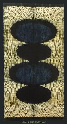 Hand woven wool, shibori resist, dyed with natural indigo and walnut.