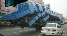 5/14/2012 Meanwhile in China: That's How you Transport Pickups! #seemslegit