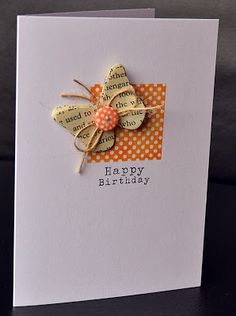 handmade Happy Birthday card ... clean and simple design ... butterfly on top of a square ... die cut layered butterfly with book paper, button and string on top ... like it!