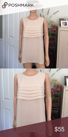 """NWOT...LOUIS FERAUD.... nude shell NWOT...Louis FERAUD... nude shell, see photos, US size 4, 100% polyester hand wash, measurements; top to bottom 27"""", bust 17"""", measured while laying flat, excellent condition, no trade, no pp, smoke and pet free environment Feraud Tops Tank Tops"""
