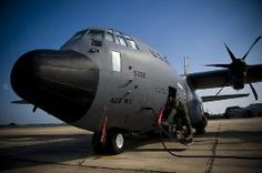 A U.S. Airman prepares a WC-130J Hercules aircraft at Keesler Air Force Base, Miss.,