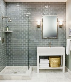 White vanity with pale blue Caesar stone top would look great with this...We love glass tile!