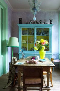 Plan on doing a variation of this to my hutch. Chartreuse inside and a raspberry-ish exterior.
