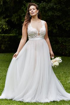 """Column-shaped brides can pull off this dreamy gown from Wtoo featuring a plunging neckline with a nipped-in waist, which creates definition. I would recommend it for brides who have a C-cup or lower since there isn't enough material to support a large bust."""