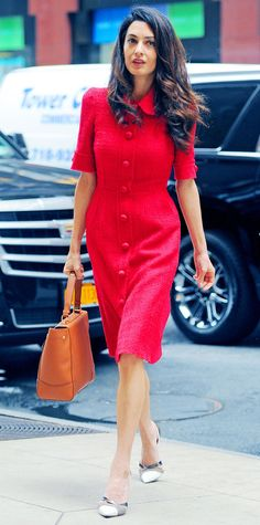 We're obsessed with Amal Clooney and her impeccable style. And since she's a professor, lawyer, activist, and all-around great human, you can bet her wardrobe is rife with serious work wear inspo. Ahead, lessons we learned from studying her outfits.