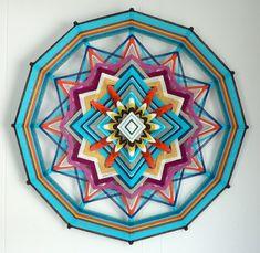 Sky Blue, an 24 inch, 12 sided, Ojo de Dios mandala, by Jay Mohler. $210.00, via Etsy.