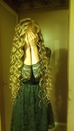 How to curl your hair in tight spiral curls with a regular curling iron in a few easy steps! 1) take a small section of your hair 2) hold your curling iron so the barrel is pointing downward 3) starting from the top, begin to wrap your hair around the outside of the barrel 4) hairspray & repeat!