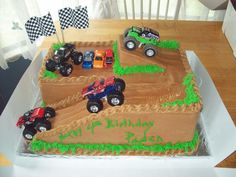 chocolate cake,bc frosting, toy monster trucks