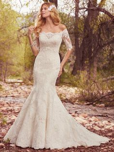 Chameleon Bride. Bournemouth  Maggie Sottero    Style: Betsy    Layers of lace appliqués and dotted tulle create romantic texture in this strapless fit-and-flare, complete with sweetheart neckline and lace hem. Finished with corset closure, or covered buttons over zipper and inner corset closure. Off-the-shoulder lace illusion jacket with elbow-length sleeves sold separately.    All Ivory (pictured)    Sample Size: UK16