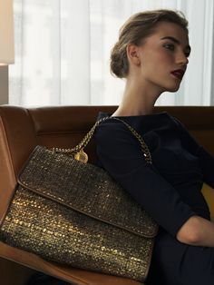 Stella McCartney's metallic tweed handbag is oh so chic.  We also adore the bold brow and Bordeaux lip.