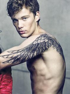 Like the idea of feathers/wings continuing down arms...