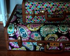 old suitcases covered with laminate fabric