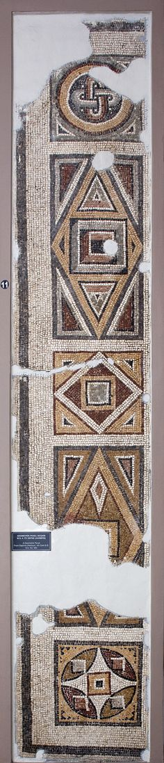 Inventory No : 985 Made on a white background, the Geometrical Mosaic has its corner piece ornamented with geometrical patterns.