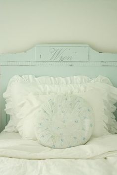 The soft green and delicate flowered pillow is very sweet.