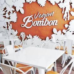 Cardboard logo installed in the sand in an amazing mural at vegan bakery Vegan Bombon. Designed by Cartonlab. #vegan #veganbakery #sustainabledecor