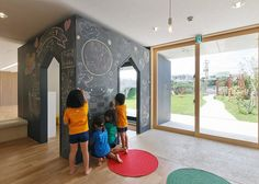 Hanazono Kindergarten designed to endure typhoons and offer outdoor play spaces.
