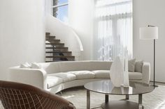 A Stunning Penthouse in Toronto   Interior Design by Alessandro Munge of Studio Munge   Photography by Evan Dion   Modern Sanctuary   Living Room   Contemporary Living Room   Seating   Staircase   Spiral Staircase