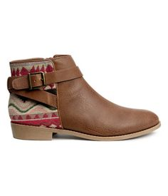 H&M LOVES COACHELLA. Ankle boots in grained imitation leather with a jacquard-weave section at back. Straps and zip at side, fabric lining, and fabric insoles. Rubber soles. Heel height 1 in. Pattern may vary from pair to pair.