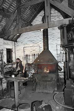Victorian blacksmith forge showing furnace and blacksmith