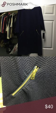 NAVY SHIFT DRESS WITH GOLD ZIPPERS Beautiful navy dress with gold zippers. Can be worn with boots for a more casual look or pumps to dress it up. Never worn before and needs a good home Dresses Midi