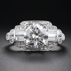 A consummate late-Art Deco platinum and diamond engagement ring blazing front and center with a gorgeous and glistening transitional European/round brilliant-cut diamond, weighing just a handful of points shy of 2.00 carats.
