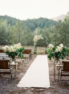 Wedding Aisle Decor - simple flower arrangements on each side as you enter the aisle