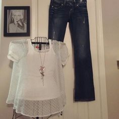 Lovely white sheer blouse Sheer white blouse with polka dots. There is white tank under shirt in pic. Cross open in back, cute shirt sleeves with button closure. Thanks for looking!! spoiled Tops Blouses