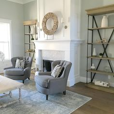Pottery Barn Cardiff Armchairs: Shelves and fireplace
