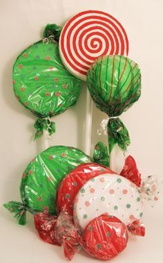 Jumbo Wrapped Candies and Lollipop Decorations infoJumbo Wrapped Candies and Lollipop Decorations. Would also be great in a more traditional wreath form!Maybe not the lollipops, but good to use as a base for other things--inspiration! Jumbo Wrapped C Candy Land Christmas, Christmas Yard, Grinch Christmas, Office Christmas, Christmas Projects, Winter Christmas, Christmas Ornaments, Christmas Ideas, Gingerbread Decorations