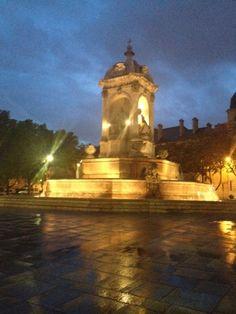Paris in the Rain, fountain at Saint Sulplice