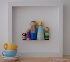 Customized Peg Doll Family Wall Art framed in shadowboxes. What a sweet idea.