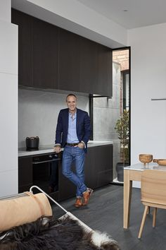 When Whiting Architects were approached to renovate a tiny Melbourne terrace on a footprint of just 96m2/1033ft2, they rose to the challenge, seeing it as an opportunity to prioritise quality over quantity. The kitchen is designed as a cohesive part of the interior, rather than a separate space, with sleek cabinetry, integrated appliances and an oven by Fisher & Paykel. Architecture by Whiting Architects. Photography by Shannon McGrath. #modernarchitecture #exteriorarchitecture #dreamhouse Kitchen Interior, Kitchen Design, Black Ovens, Indoor Courtyard, Monochrome Color, Signature Design, Soft Furnishings, Melbourne Victoria, Victoria Australia