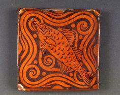 Maw Tile with fish design. Shrewsbury Museums Service