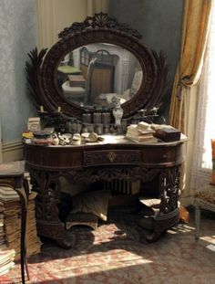 They found this exquisite vanity, which held glass perfume bottles and cosmetics. What woman wouldn't love to own this?
