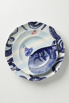 Dinner ware, decals or hand painting don't care love the idea of having a charger and dinner plate that relate. #inspiration