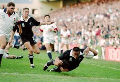 Jonah Lomu of New Zealand dives over for the try during the 1995 Rugby World Cup match between England and New Zealand played in Cape Town South...