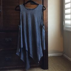 Trapeze tank top Super soft and comfy gray trapeze tank top. Love pairing this with blank skinnies and a bold necklace! Always got compliments for this one :) fits bigger then a M. H&M Tops Tank Tops