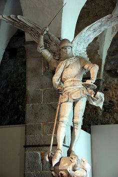 Statue of Saint Michael the Archangel defeating the dragon. Mont Saint Michel France, Le Mont St Michel, Saint Michael Statue, St Michael, Cathedral Architecture, Art And Architecture, Angel Warrior, Archangel Michael, The Beautiful Country